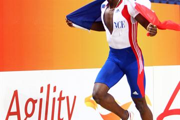 An agile Teddy Tamgho of France celebrates his new World indoor record in the Men's Triple Jump with lap of honour (Getty Images)