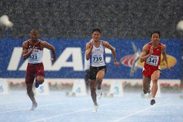 Unexpected torrential rain during the men's 100m morning heats (Getty Images)