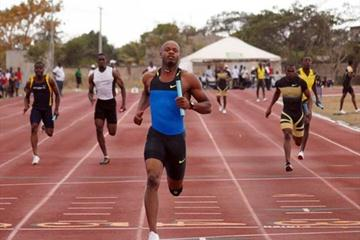 Asafa Powell anchors the MVP 4x100m relay squad at the GC Foster Sports College near Spanish Town (Paul Reid)