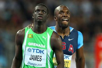Kirani James (front) of Grenada and LaShawn Merritt of United States look to the scoreboard after finishing the men's 400 metres final during day four  (Getty Images)