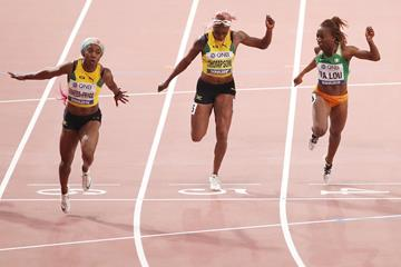 Shelly-Ann Fraser-Pryce collecting her fourth world 100m title in Doha (Getty Images)