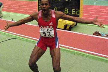 Cuba's Ivan Pedroso celebrates winning the long jump title in Maebashi (© Allsport)