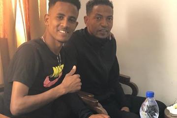 Tachlowini Gabriyesos with Zersenay Tadese ()