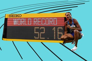 Dalilah Muhammad with her world record figures on the clock in Doha (AFP / Getty Images)