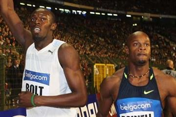 Usain Bolt and Asafa Powell both of Jamaica after the 100m race (Getty Images)