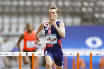 Karsten Warholm en route to the ISTAF meeting record (AFP/Getty Images)