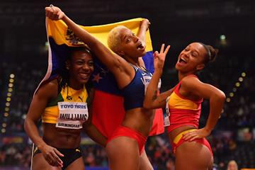 Kimberly Williams, Yulimar Rojas and Ana Peleteiro celebrate their top-three finish at the IAAF World Indoor Championships Birmingham 2018 (Getty Images)
