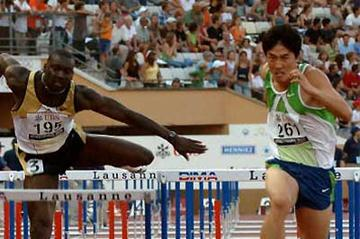 Liu Xiang sets the World 110m Hurdles record in Lausanne (AFP / Getty Images)