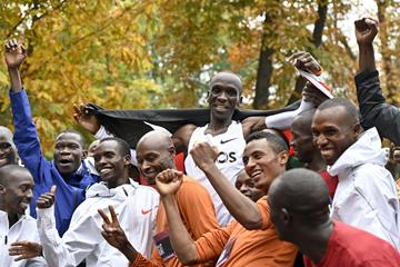 Eliud Kipchoge celebrates with some of the 41 pacesetters who helped him break two hours in Vienna (AFP/Getty Images)