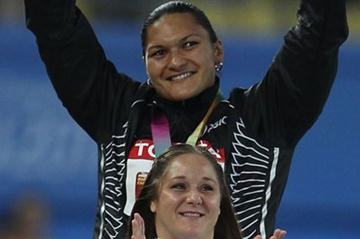 Gold medalist Valerie Adams of New Zealand and bronze medalist Jillian Camarena-Williams of United States celebrate on the podium with their medals for the women's shot put final (Getty Images)