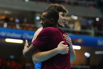 Ivan Ukhov congratulates high jump winner Mutaz Essa Barshim at the 2014 IAAF World Indoor Championships in Sopot (Getty Images)