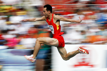 Dong Bin of China in action in the triple jump (AFP / Getty Images)