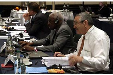 IAAF Council, London - Lamine Diack (SEN) and Pierre Weiss (FRA) with Sergey Bubka in the background (Chris Turner for the IAAF)