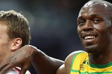 Usain Bolt of Jamaica puts his arm on the shoulder of Christophe Lemaitre of France after his Men's 200m Semifinals on Day 12 of the London 2012 Olympic Games on 8 August 2012 (Getty Images)