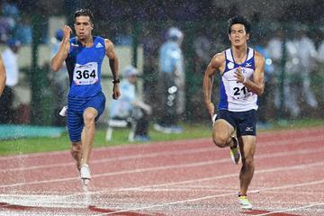 Hassan Taftian (l) splashes to the Asian 100m title in Bhubaneswar (AFP/Getty Images)