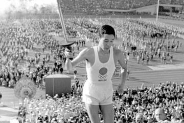 Yoshinori Sakai about to light the flame at the 1964 Olympic Games (Getty Images)