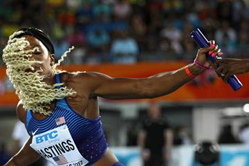Natasha Hastings gets the baton from teammate Quanera Hayes in the heats of the 4x400m in Nassau  (Getty Images)
