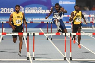 Kyron McMaster en route to his 47.60 CAC Games record (AFP/Getty Images)