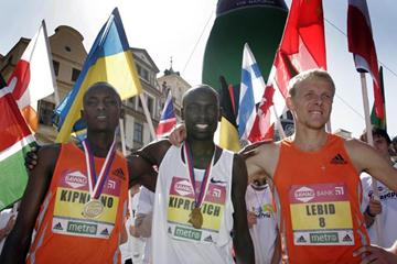 Wilson Kiprotich Kebenei (centre) winner of the Prague 10km race (Prague)
