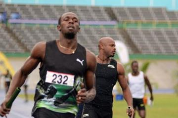 Usain Bolt anchors home the relay at the 2012 UTech Classic (Anthony Foster)
