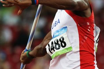 Yordani Garcia of Cuba produces the furthest javelin throw of the first group in the decathlon (Getty Images)