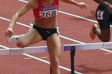 Stina Troest on her way to a silver medal in Singapore 2010 (Lars Nielsen)