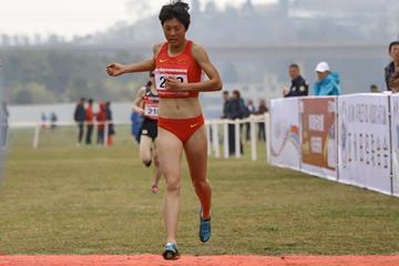 Li Dan of China winning the Asian cross country title in Guiyang (Rahul Pawar/AAA)