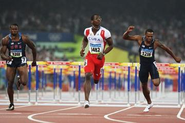 Dayron Robles crosses the line first ahead of David Payne in second and David Oliver in third (Getty Images)