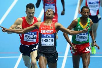 Homiyu Tesfaye wins his 1500m heat at the 2014 IAAF World Indoor Championships in Sopot (Getty Images)
