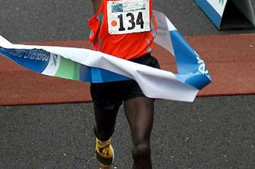 Men's winner of the Standard Chartered Singapore Marathon - Amos Matui of Kenya (c)