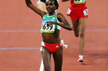 Tirunesh Dibaba records the second fastest time in history to win the women's 10,000m Olympic title in Beijing (Getty Images)