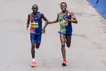 Lawrence Cherono and Lelisa Desisa approach the finish line at the Boston Marathon (AFP / Getty Images)