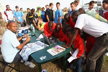 IAAF Ambassadors Mike Powell of USA and Wilson Kipketer of Denmark meet athletes (Getty Images)