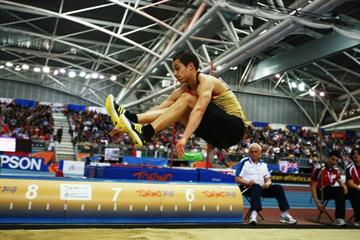 Germany's Sebastian Bayer flies out to the second best indoor long jump of all time (Getty Images)