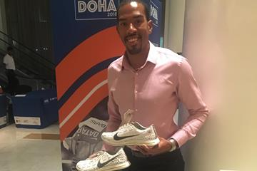 Christian Taylor with the spikes he's donated to the IAAF Heritage collection (IAAF)