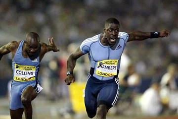 Dwain Chambers (r) outdips Kim Collins to win the men's 100m in London (Getty Images)