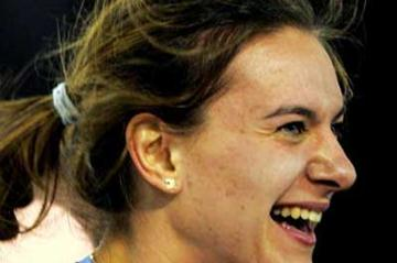 A smiling Yelena Isinbayeva after her 4.89m World Indoor record in Liévin (AFP/Getty Images)