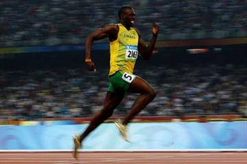 Usain Bolt stretches away from the rest of the field to win the Olympic 200m title in 19.30 (Getty Images)