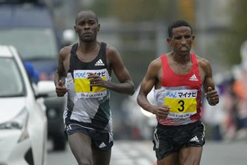 Yemane Tsegay (r) and Patrick Makau (l) and Yemane Tsegay (r) at the 2016 Fukuoka Marathon. Tsegay won the race with Makau second. (Kabuki Matsunaga/Agence SHOT)