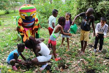 Championships mascot Tangarita and local children prepare the themed parks near the warm up stadium (IAAF World Youth Championships, Cali 2015 LOC)
