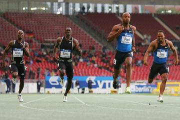 Asafa Powell runs 9.87 to lead a Jamaican 1-2-3 in the 100m (Getty Images)