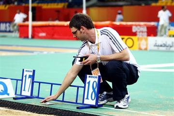 A Seiko official checks the newly introduced video distance measurement system in the Aspire Dome in Doha (Getty Images)
