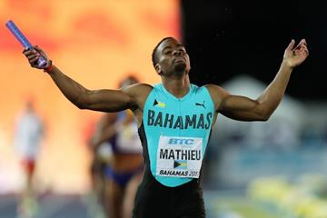 Michael Mathieu crosses the finish line to win the mixed 4x400m in Nassau (Getty Images)