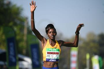 Purity Rionoripo en route to a course record at the Paris Marathon (AFP)
