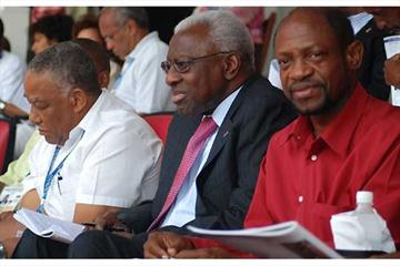 IAAF President Lamine Diack (centre), St. Kitts and Nevis Prime Minister Dr. Denzil Douglas (right) and IAAF Council Member Neville 'Teddy' McCook watch the opening day of the 2008 CARIFTA Games (Anthony Foster)