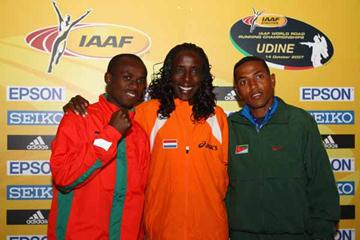 Lornah Kiplagat of the Netherlands with Zersenay Tadesse of Eritrea and Samuel Wanjiru of Kenya during the Press Conference (Getty Images)