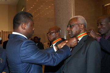 Togo President Faure Essozimna Gnassingbe presents the Commander of the Order of Mono award to President Diack  (IAAF)