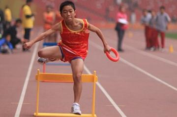 Kids participating in a shuttle hurdles race at the China National Kids Athletics Games in Beijing's Bird Nest Stadium (organisers)