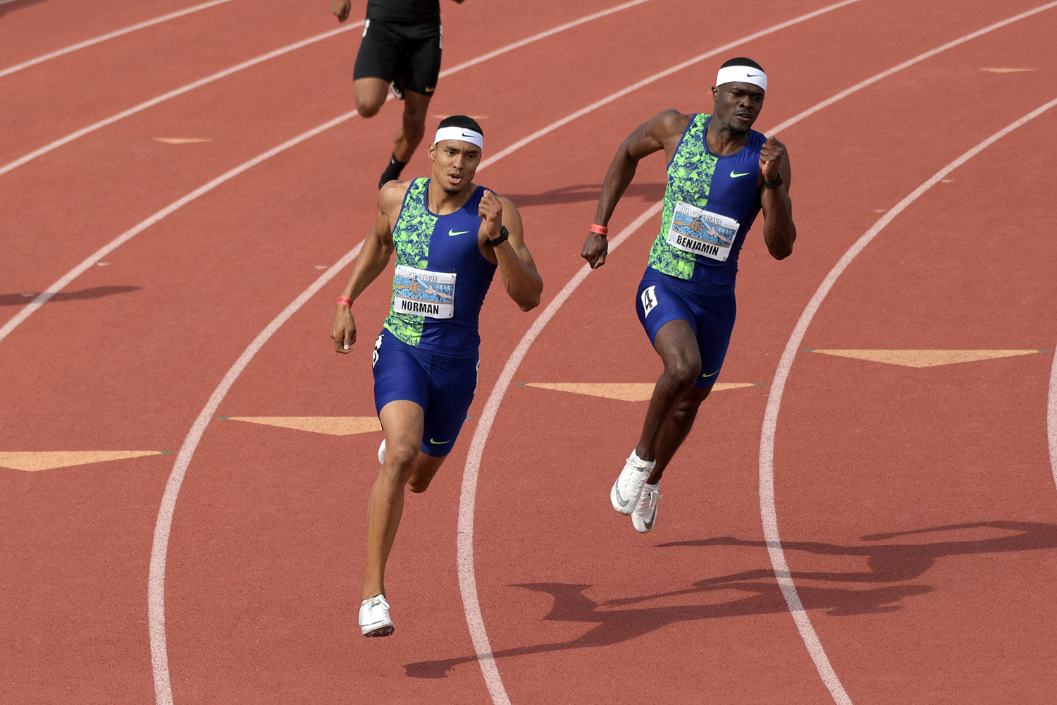Michael Norman leads from Rai Benjamin in the 400m at the Mt SAC Relays (Kirby Lee)