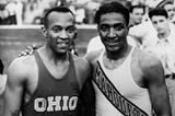 Jesse Owens and Ralph Metcalfe (Getty Images)